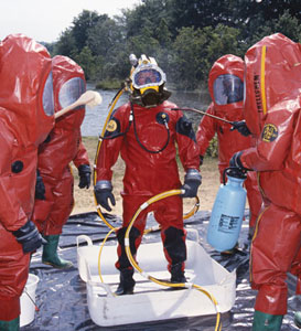 A Diver Undergoing Simulated Decontamination Is Cleaned By